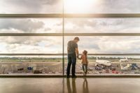 Silhouette of family, father and daughter on airport terminal