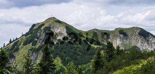 Panorama of Mount Hoher Ziegspitz, 1864 m with Summit Cross in Ammergauer Alps, in Garmisch-Partenkirchen, Upper Bavaria, Germany