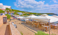 Beach with open air cafe in Agia Marina
