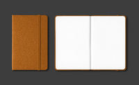Leather closed and open notebooks isolated on black