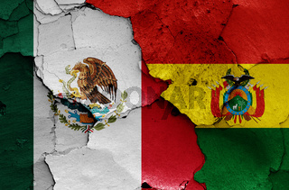 flags of Mexico and Bolivia painted on cracked wall