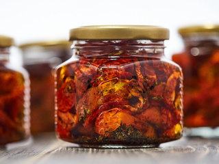 Canned sun dried red cherry tomatoes.