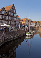 Historic houses at the Hanseatic harbor with the sailing ship Willi, Stade, Germany, Europe
