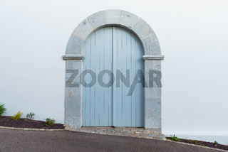 Light blue arched door