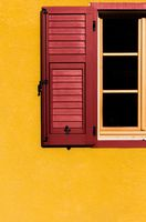 contrast between red window open on yellow wall