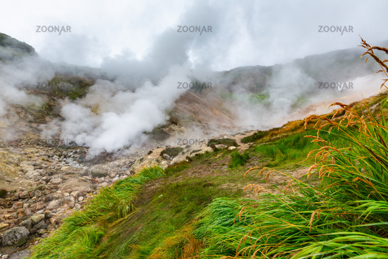 Thrilling view of volcanic landscape, aggressive hot spring, erupting fumarole, gas-steam activity