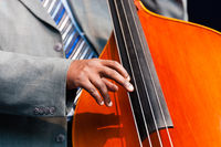 Man playing a double bass in an orchestra
