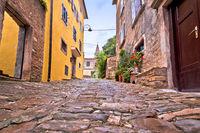 Buje. Old adriatic town of Buje stone street and church view