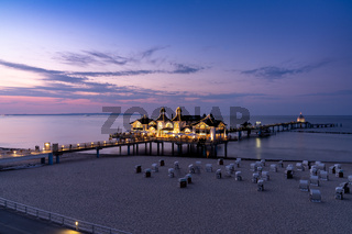 view of the Sellin pier on Ruegen Island on the Baltic Sea at sunset