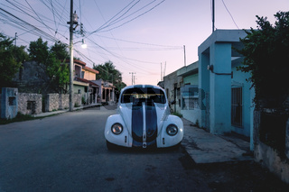 Pimped old beetle volkswagen car in the streets of Valladolid during sunset, Yucatan, Mexico