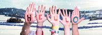 Children Hands Building Word Hello, Snowy Winter Background