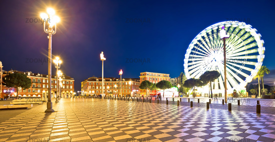 City of Nice giant ferris wheel and Massena square evening panoramic view