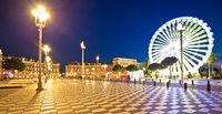 City of Nice giant ferris wheel and Massena square evening panoramic view