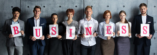 People holding BUSINESS letters