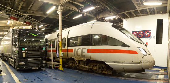 Train and truck inside ferryboat