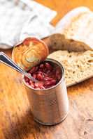 Canned red beans in tomato sauce in tin can.