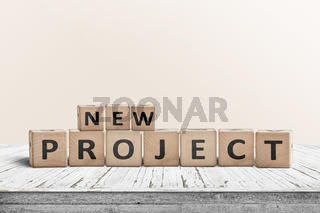 New project message on a wooden table