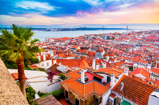 Beautiful panorama of old town and Baixa district in Lisbon city during sunset, seen from Sao Jorge Castle hill, Portugal
