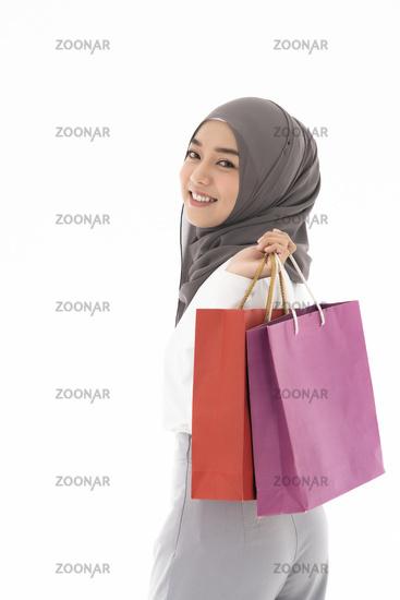 Muslim girl shopping bags
