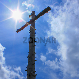 Summit Cross of Mount Hinteres Hörnle, 1548 m in Ammergauer Alps, located in Bad Kohlgrub, Upper Bavaria, Germany