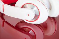 White red headphones on vinous surface