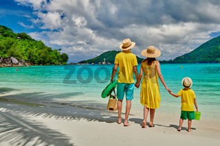 Family with three year old boy on beach. Seychelles, Mahe, Port Launay.