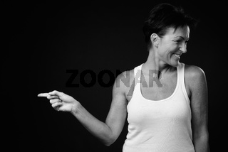 Portrait of happy mature beautiful woman with short hair