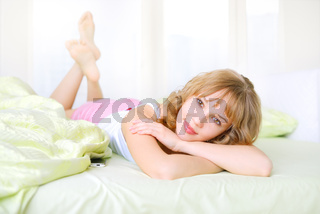 Beautiful girl lying on a bed
