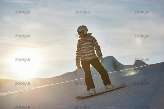 Snowboarder in sun flare, water drops on lens