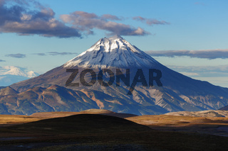 Autumn mountain landscape - scenery view of snow-capped cone of volcano
