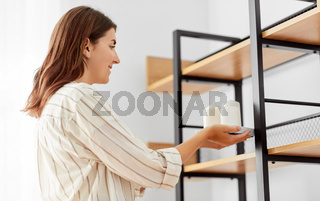 woman decorating home with candles