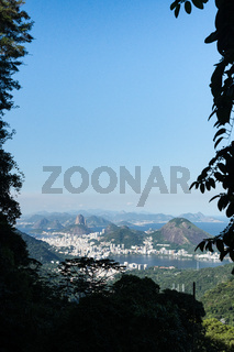 Aerial view over the city of Rio de Janeiro from Pedra da Proa in the mountains of the Tijuca Forest