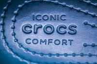 Calgary, Alberta, Canada. Nov. 19, 2020. A Crocs footwear inside shoe with the text: Iconic Crocs Comfort.