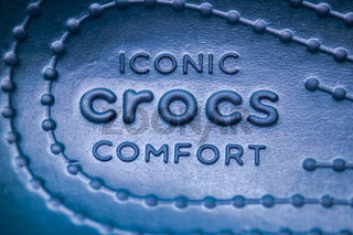 Calgary, Alberta, Canada. Nov. 19, 2020. A Crocs footwear inside shoe with the text: Iconic Crocs Comfort.
