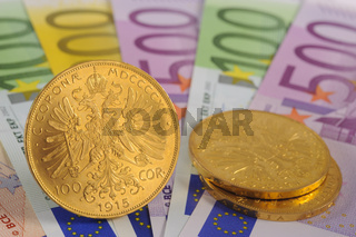 gold coin and euro banknotes