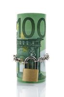 Locked money roll of Euro banknotes, 100 Euro on top, front view, isolated on white background. Saving, insurance, wealth concept
