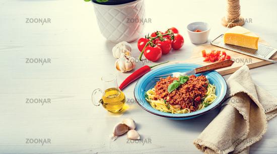 Delicious spaghetti bolognese on white background