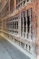 Interleaved wooden ornate wall - Mashrabiya -at abandoned building