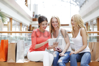 Women with tablet in mall