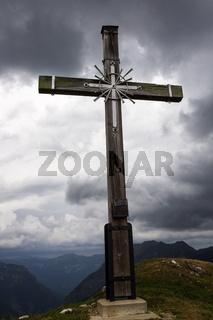 Summit Cross of Mount Hoher Ziegspitz, 1864 m in Ammergauer Alps, in Garmisch-Partenkirchen, Upper Bavaria, Germany