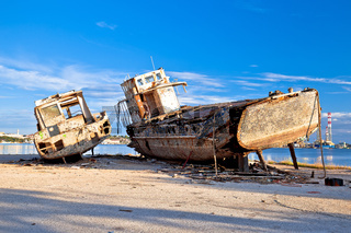 Old wooden boats wreck decay by the sea