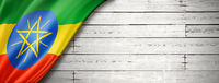 Ethiopian flag on old white wall banner