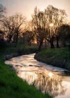 Sunrise on a bend of river wulka in burgenland