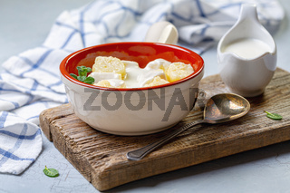 Traditional cottage cheese gnocchi with sour cream sauce.