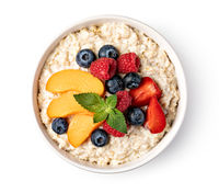 prepared oatmeal with fruits and berries