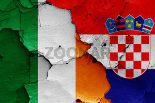flags of Ireland and Croatia painted on cracked wall
