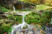Fairytale by the river beautiful cascades and an old bridge in Orbaneja del Castillo, Burgos, Spain.
