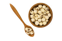 Dried lotus seeds in wooden bowl and wooden spoon on white background with clipping path.
