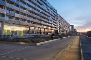 Urban building blocks reflecting sunset light