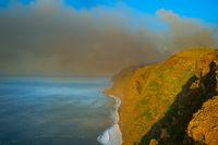 Smoke burning forest ocean Madeira